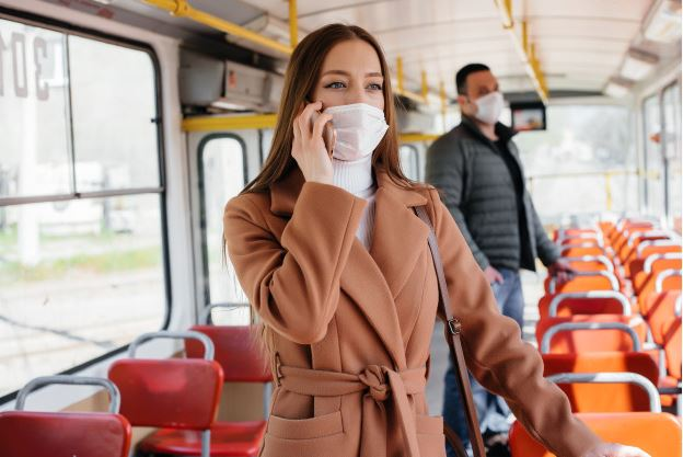 woman with mask on public transport